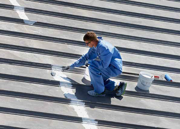 installing silicone roof coatings on commercial building in Colorado Springs